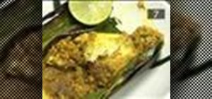 Cook fish wrapped in banana leaf