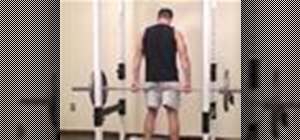 Do reverse barbell shrugs to exercise the back