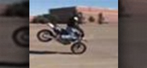 Pull a stoppie trick on a sport bike