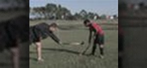 Play defense in a game of field hockey