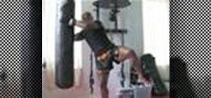 Do a kickboxing hooking knee strike