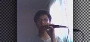 Perform a KCH snare sound beatboxing
