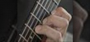 Play a B minor chord on the guitar