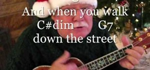 "Play ""Have a Holly Jolly Christmas"" on the ukulele"