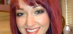 Create a red, orange, and yellow sunset eye look to flatter blue eyes