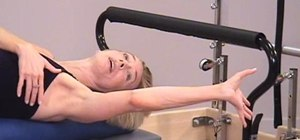 Do roller arm exercises with the on a Pilates Reformer