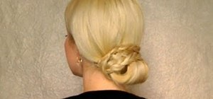 Style an elegant braided low bun hairdo (for long hair)