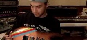 Play a seven string electric guitar riff