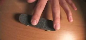 Do a fingerboard kickflip trick