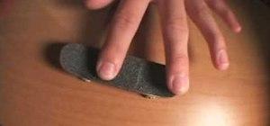 Do a fingerboard kickflip trick