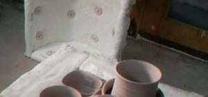 Unload and repack bisque pottery from a kiln