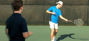 Practice forehand swing to contact in tennis
