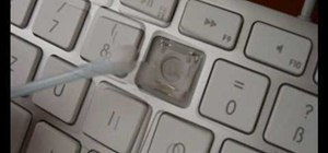 Clean an aluminum Apple keyboard by removing its keys