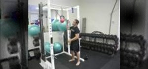 Do a kettlebell chin up exercise to strengthen your Muay Thai clinch