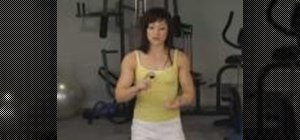 Tone your abs and arms with an exercise ball and weights