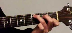 Strum chords from C to Am on acoustic guitar