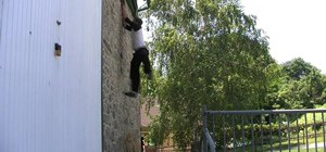 "Do a tricky ""wall up"" or ""wall climb"" parkour move"