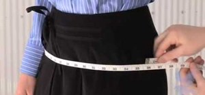 Measure a woman's hip circumference for a suit