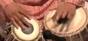 Perform a peshkar on the tabla