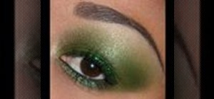 Apply smokey green eye makeup with green glitter