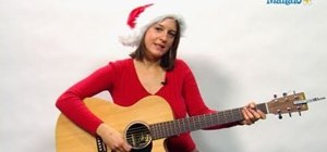 "Play ""Last Christmas (I Gave You My Heart)"" on the acoustic guitar"