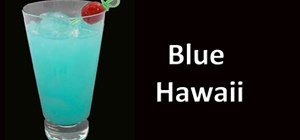 Mix a tropical blue lagoon cocktail