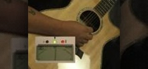 Tune an acoustic guitar with an electric tuner