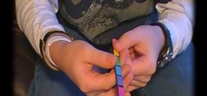 "Perform the ""color changing popsicle stick"" trick"