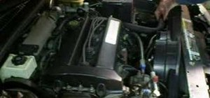 Remove the engine cooling fan motor in a Saturn car