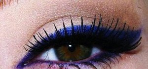 Create a shocking purple and blue winged eyeliner look