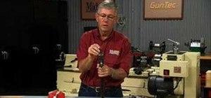 Lubricate a break open shotgun to reduce wear