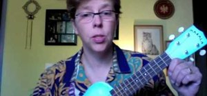 Hold and strum a ukulele
