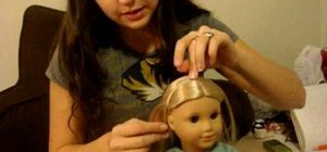 Do a hair headband on your American Girl doll