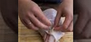 Disassemble a turkey into parts for roasting