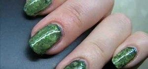 Create a black and green mottled nail look