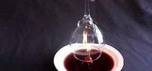 Suck wine into an upside down glass
