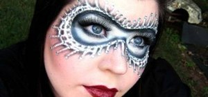 Apply a black & white masquerade mask with makeup