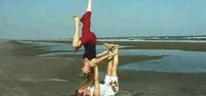 Do a backward shoulder stand yoga pose with a partner