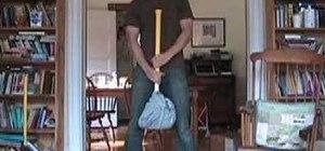 Do the butter churning sledgehammer workout exercise