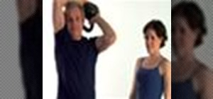 Do a Turkish get up exercise with a kettlebell