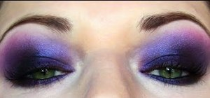 Create a dramatic electric purple futuristic makeup look