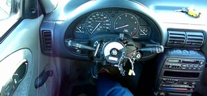Remove the multifunction switch from your Saturn S-Series automobile