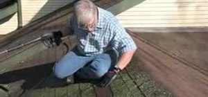 Use a pressure washer to clean asphalt roof shingles