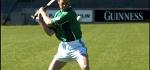 Practice striking the ball from the hand in hurling