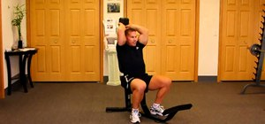 Do a seated dumbbell overhead press to tone triceps and arms