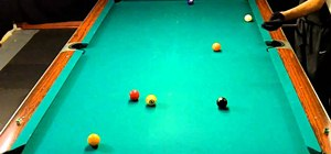 Play a 9-ball billiards game of kick pool