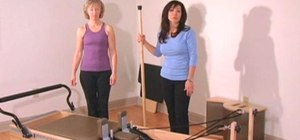 Perform an advanced Pilates Reformer balancing routine
