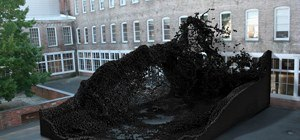 Massive Geometric Sculpture Resembles Tsunami of Black Caviar