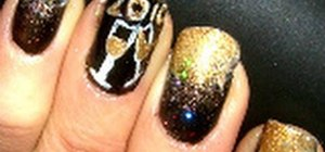 Apply gold champagne New Years nail art for New Years