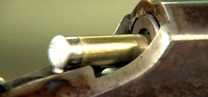 Extract a broken shell from the chamber of a rifle